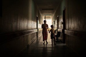 A woman and child walk down the isle from the National Paediatric Hospital in Phnom Penh during the 2012 dengue epidemic. Phnom Penh, Cambodia.