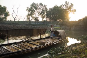 """Ranjeet cleans his boat after a night's work. """"It's not possible to support a family with this profession anymore"""", says Ranjeet, who has fished with otters for over 30 years. As rivers dry up and the fish population decreases, Ranjeet and his team barely make a living."""