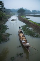 """Ranjeet's boat cruises along the waterways of the Garai river. """"It's not possible to support a family with this profession anymore"""", says Ranjeet, who has fished with otters for over 30 years. As rivers dry up and the fish population decreases, Ranjeet and his team barely make a living."""