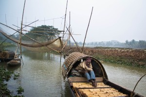 A fisherman on his boat. During winter, the fishermen spend up to 8 hours on the boat without proper winter clothes.