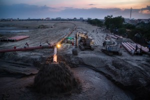 Pipelines and excavators fill in the Boeung Kak lake. Without a proper drainage system—the lake's waters flooded thousands of homes in the area, forcing families to leave.
