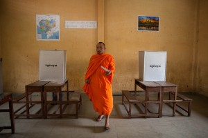 A Buddhist monk casts his vote at Wat Phnom Bunrang High School voting station in Phnom Penh.