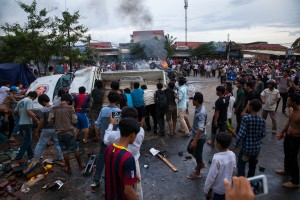Mobs attack and burn two police cars at Stung Meanchey District in Phnom Penh.  Later on they attacked a man they thought to be Vietnamese.