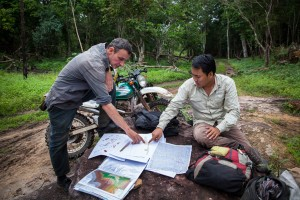 ADF's archaeologists Dr. Jean-Baptiste Chevance and Sakada Sakhoeun, inspect maps from the Phnom Kulen area. Siem Reap Province, Cambodia.