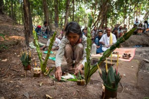 An elderly woman assists during an offering to the spirits prior excavation by the ADF team in Phnom Kulen. Siem Reap Province, Cambodia.