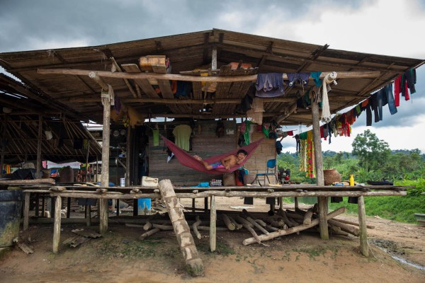 An Embera man rests in a hammock in Bacal indigenous community in Alto Baudó. The community has been forcibly displaced for years due to the conflict in the region among illegal armed groups operating in the region.