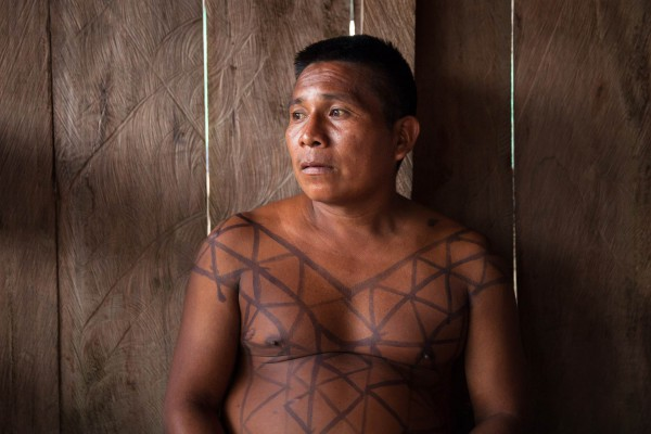 "Ornelio Forastero, a 38 year-old leader from the Embera indigenous community in Bacal, Alto Baudó. ""We don't know what really happened, but we heard loud explosions, gunshots. We got scared and ran away, we went up the river and camped on the riverbank for days."" The community has been forcibly displaced for years due to the conflict in the region among illegal armed groups operating in the region."