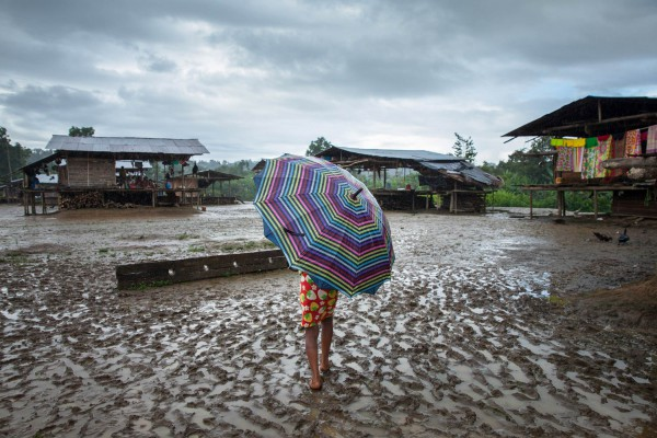 An Embera girl walks through Bacal indegenous community on the riverbank of the Baudó River. The community has been forcibly displaced for years due to the conflict in the region among illegal armed groups operating in the region.