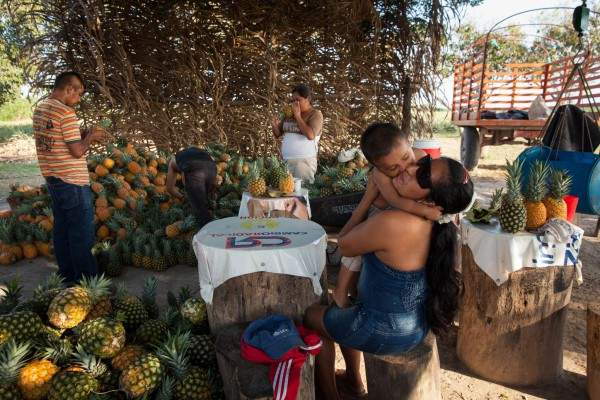 """María Yasmín, 26, grew up in one of Colombia's most dangerous zones. She now lives with her 2 year-old son in La Fortuna, where she works as a cook and house manager. """"I was born and grew up in the conflict."""" She says. """"The paramilitaries where the ones we feared the most. But the past is the past, and we don't have to remember the bad things anymore… Don Humberto has always been very good to me and my son, since I met him."""""""